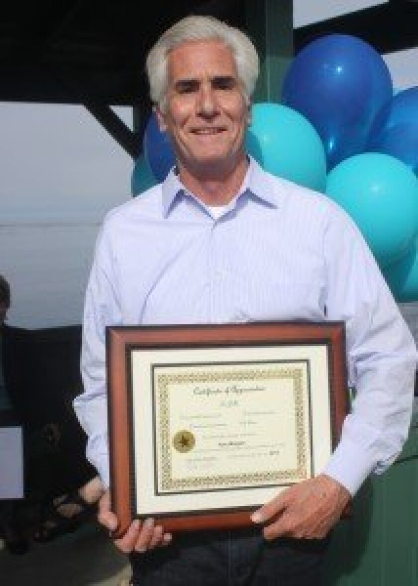 Tom Morgan with a certificate of appreciation for his $200,000 donation to the project.
