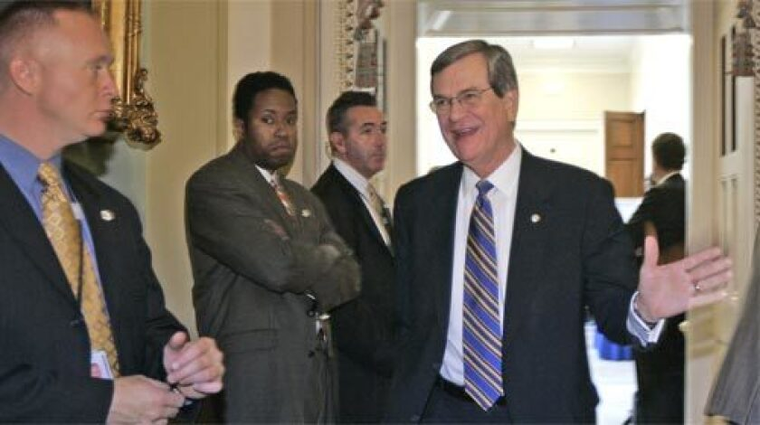 FAREWELL: Senators spent as much time Tuesday delivering tributes to retiring Sen. Trent Lott, right, who is ending a 35-year career in elected office this week, as they did debating the war.