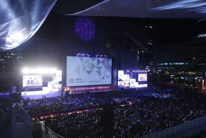 FILE - In this Oct. 1, 2015, file photo, people attend the opening ceremony of the Busan International Film Festival at Busan Cinema Center in Busan, South Korea. The future of Asia's largest, most-awaited film festival is in question as local filmmakers threaten to boycott the red carpet over what