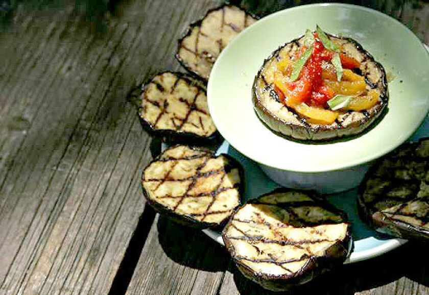 Thick slices of eggplant brushed with olive oil capture a grill's smokiness, while slow-roasted red and yellow peppers add a sweet dimension. Recipe: Grilled eggplant with red and yellow peppers