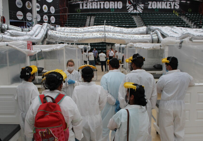 Doctors Without Borders arrives at the Tijuana Zonkeys basketball arena, turned into a temporary coronavirus unit, to begin work accepting non-critical COVID-19 patients Wednesday.