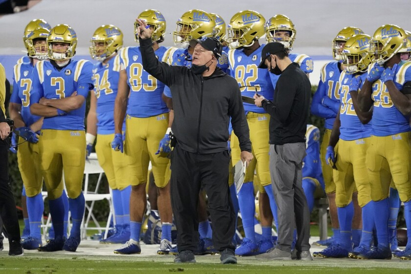 UCLA coach Chip Kelly signals from the sideline during the second half against Arizona on Saturday.