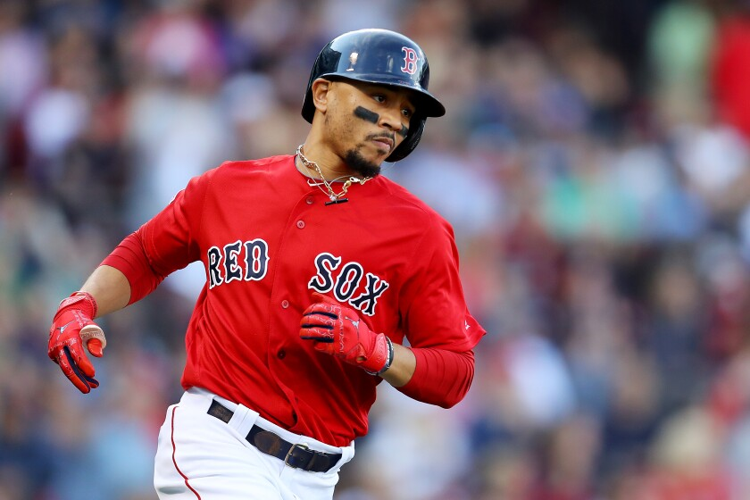 Mookie Betts runs towards first after hitting a single against the Baltimore Orioles during the third inning on Sept. 29 in Boston.