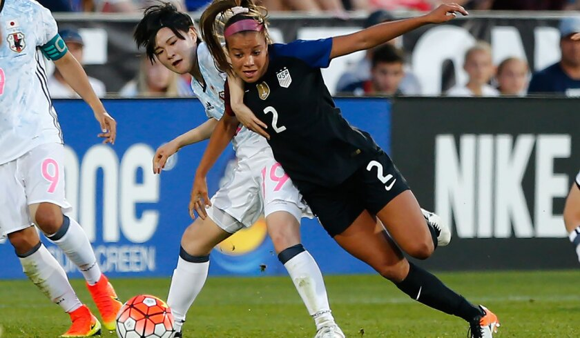 U.S. midfielder Mallory Pugh, right, moves around Japan defender Mayu Sasaki on June 2.