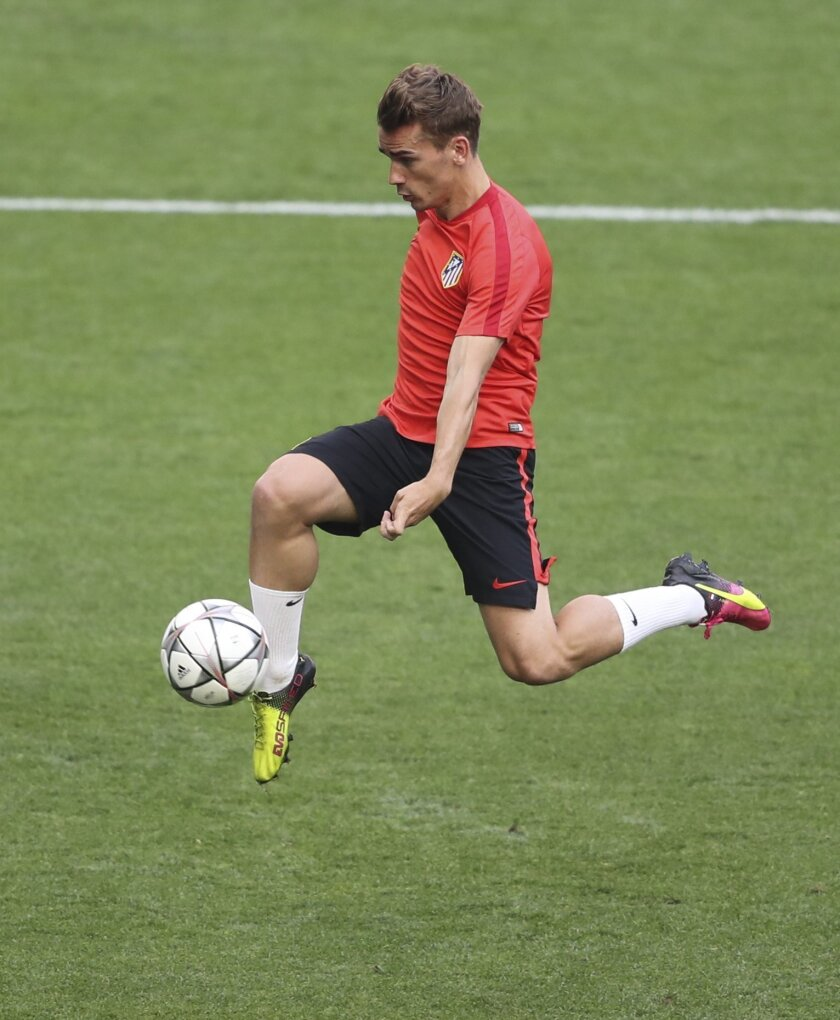 Atletico's Antoine Griezmann kicks the ball during a training session at the San Siro stadium in Milan, Italy, Friday, May 27, 2016. The Champions League final soccer match between Real Madrid and Atletico Madrid will be held at the San Siro stadium on Saturday, May 28. (AP Photo/Antonio Calanni)