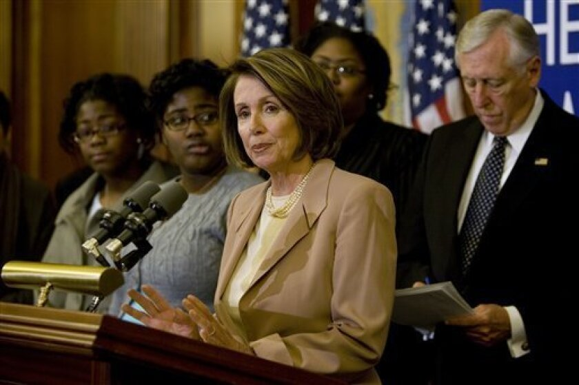 House Speaker Nancy Pelosi of Calif., accompanied by House Majority Leader Steny Hoyer of Md., right, and others, speaks during a news conference on Capitol Hill in Washington, Wednesday, Jan. 14, 2009, after the House passed State Children's Health Insurance Program (SCHIP) legislation. (AP Photo/