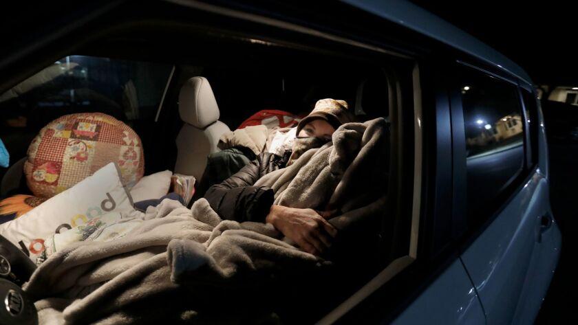 SANTA BARBARA, CA DECEMBER 20, 2017: Marva Ericson, 48, gets ready to fall asleep in a Santa Barb