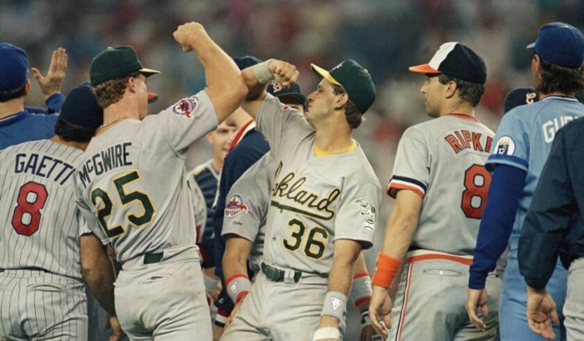 Catcher Terry Steinbach (36) gets a forearm bash from Oakland A's teammate Mark McGwire following the AL's victory over the NL in the 1988 All-Star Game.