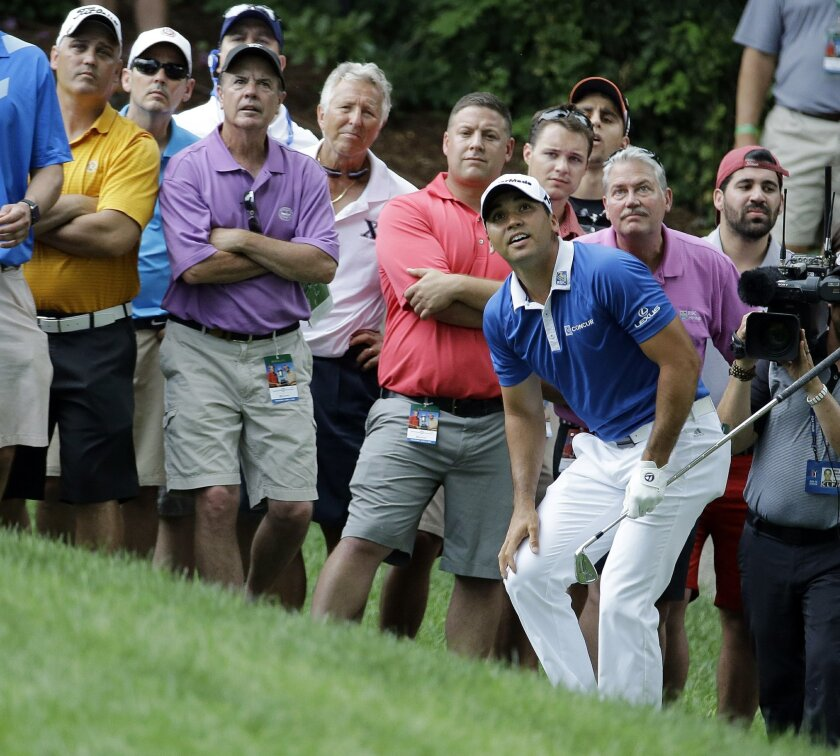 Jason Day, of Australia, watches his shot to the ninth green during the first round of the Memorial golf tournament, Thursday, June 2, 2016, in Dublin, Ohio. (AP Photo/Darron Cummings)