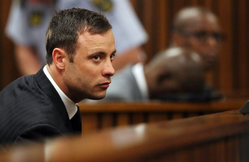 South African Olympic and Paralympic athlete Oscar Pistorius listens to the verdict during his murder trial in September.