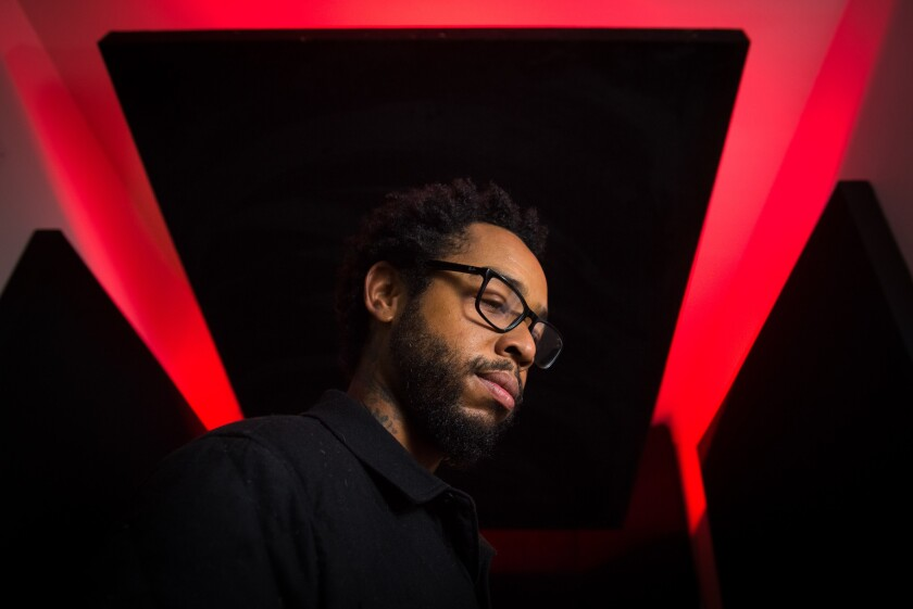 """Terrace Martin stands in a recording booth at """"The Sound of Crenshaw Ranch."""""""