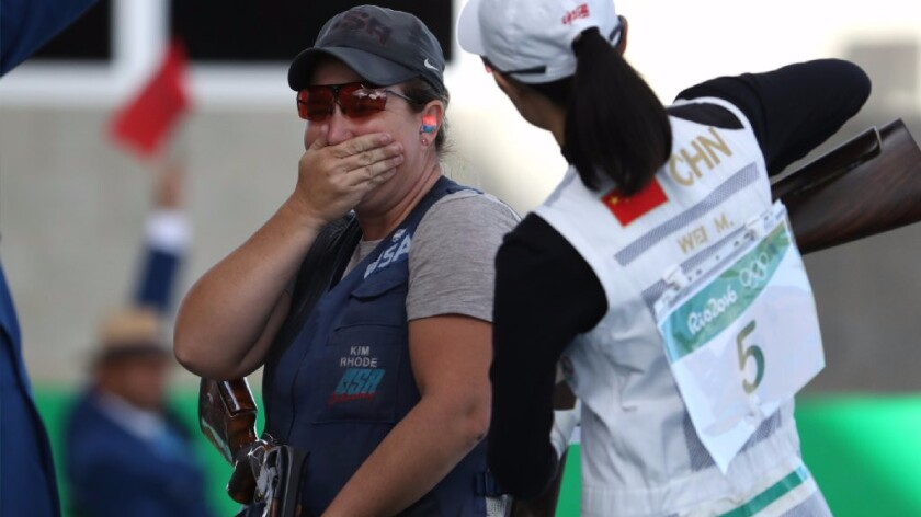 Kim Rhode tries to hold in her excitement after defeating Wei Meng of China, right, in a shootout for the bronze medal.
