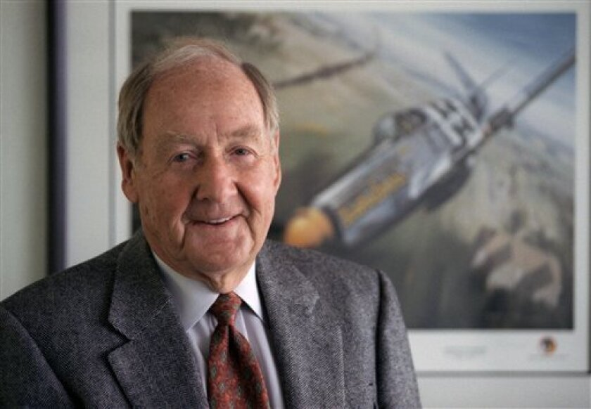 In this April 1998 photo,Ken Dahlberg stands in front of a painting of a Mustang fighter he flew in WWII in St. Louis Park, Minn. Minnesota businessman Kenneth Dahlberg, an inadvertent figure in the Watergate scandal that brought down Richard Nixon's presidency, has died. He was 94. (AP Photo/The Star Tribune, Tom Sweeney) MANDATORY CREDIT; ST. PAUL PIONEER PRESS OUT; MAGS OUT; TWIN CITIES TV OUT