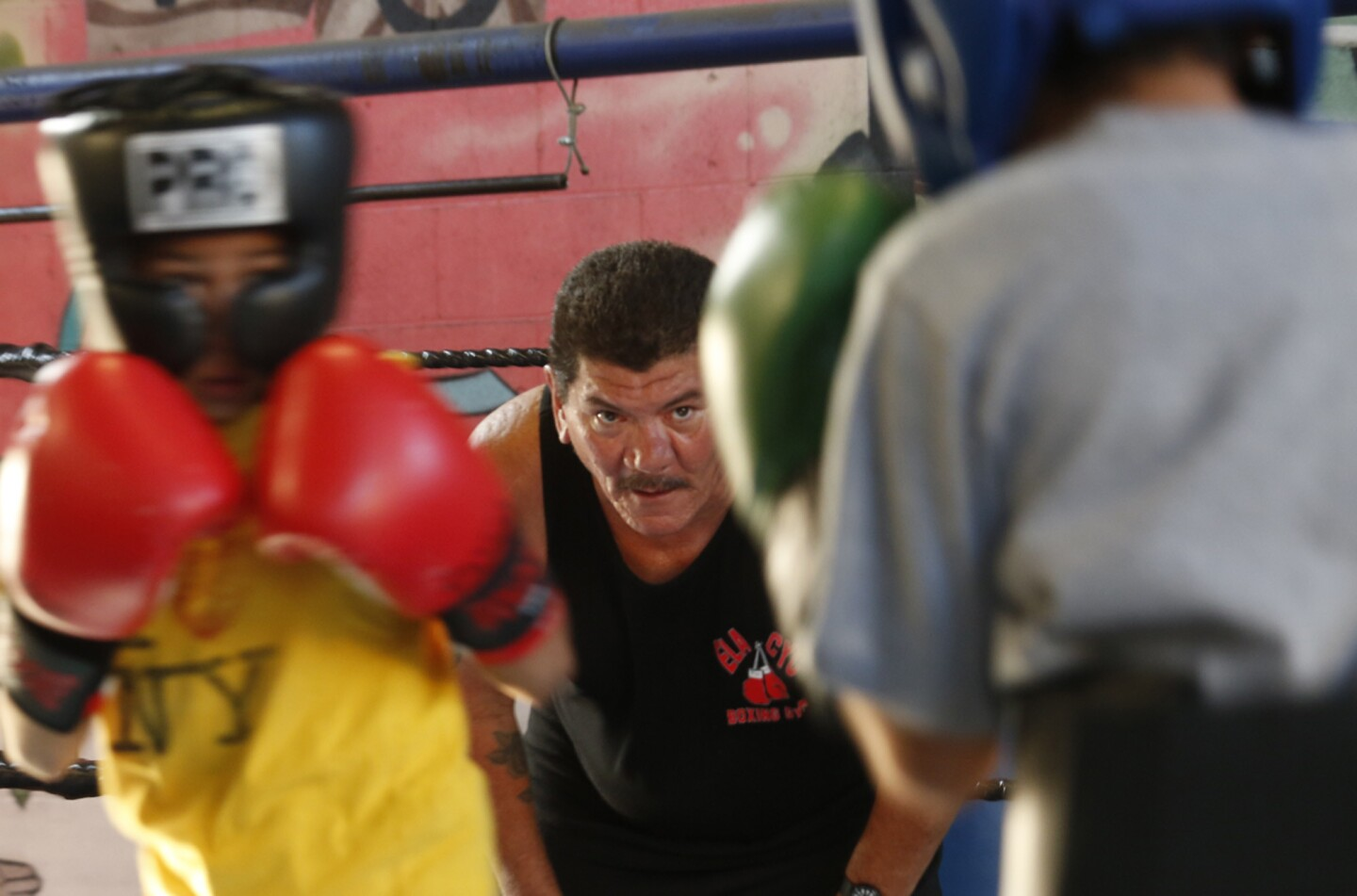 Boxing coach Paul Hernandez, 58, coaches and referees a sparring match between two young boxers at the East Los Angeles Community Youth Center in East Los Angeles on July 1. Hernandez has been fighting to keep the gym from closing due to the possible purchase of the property by a charter school.