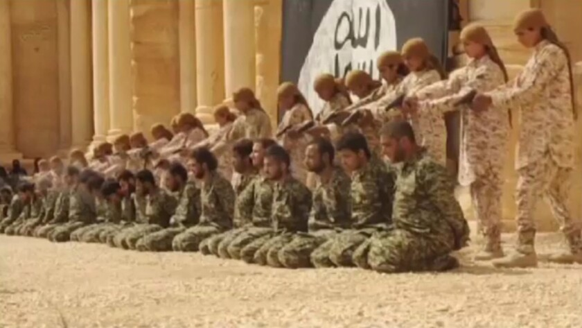 A video released by Islamic State shows militants executing 25 Syrian army soldiers in the ruins of