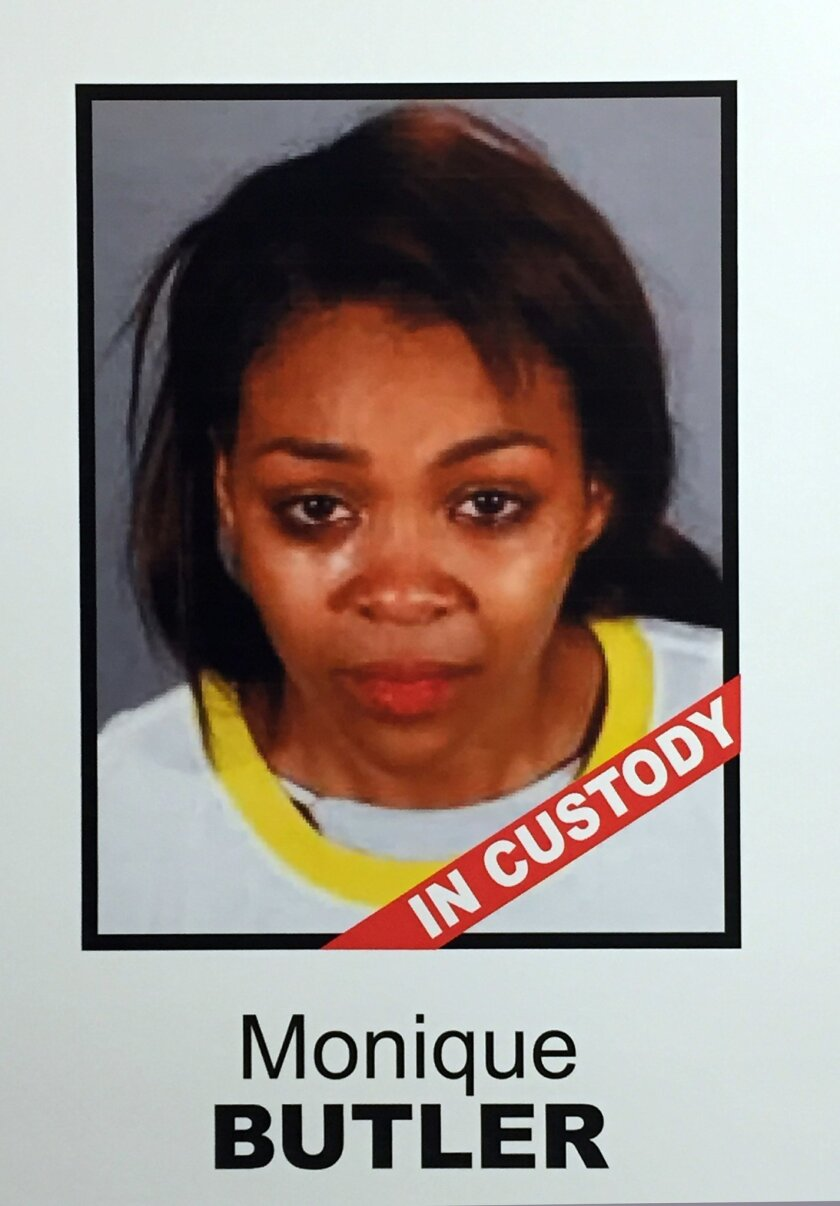 A photo of Monique Butler is shown on a poster at a news conference where Los Angeles County Sheriff Jim McDonnell announced that three people have been arrested for trafficking a Los Angeles woman after fooling her into thinking she was going to a birthday party, at a news conference in Los Angele