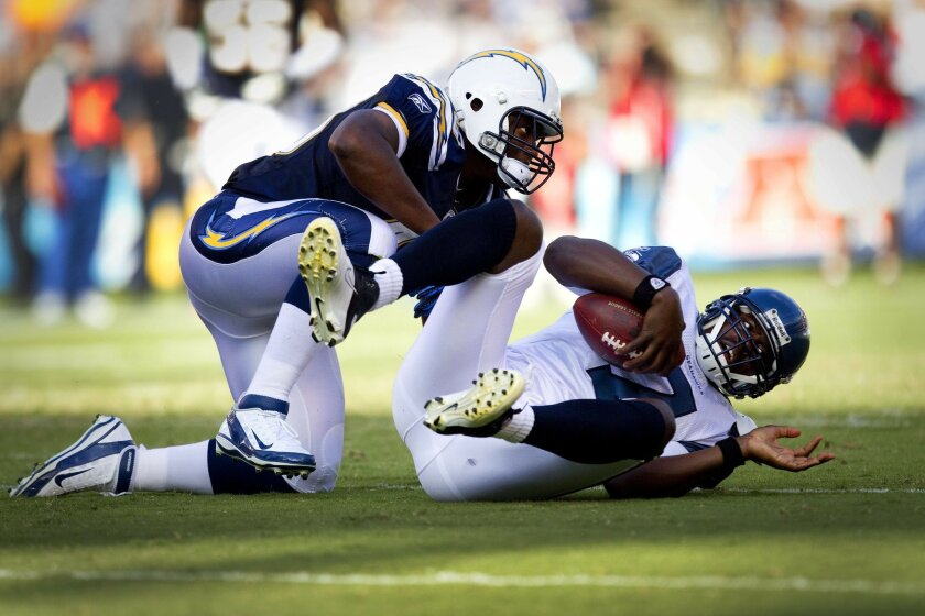 Chargers linebacker #49 Darryl Gamble tackles Seahawks quarterback #7 Tarvaris Jackson for a loss late in the first quarter.