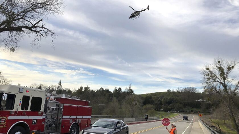 A helicopter and Stanislaus Consolidated Fire Protection District are on the scene on the bridge ove