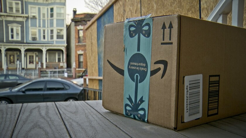 This image taken from video shows an Amazon package containing a GPS tracker on the porch of a Jerse