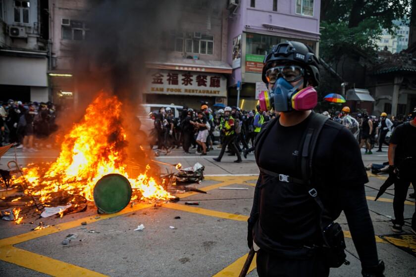 Pro-democracy demonstrators in Hong Kong retreat as police advance.