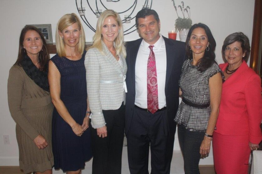 St. Germaine Children's Charity president Wendy Neri, vice-president of programs Besty Witt, vice-president of publicity Nicole Hall-Brown, San Diego Rescue Mission's Michael Johnson, St. Germaine vice-president of philanthropy Coco Bancroft and Rescue Mission development manager Robin Colberg. Ter