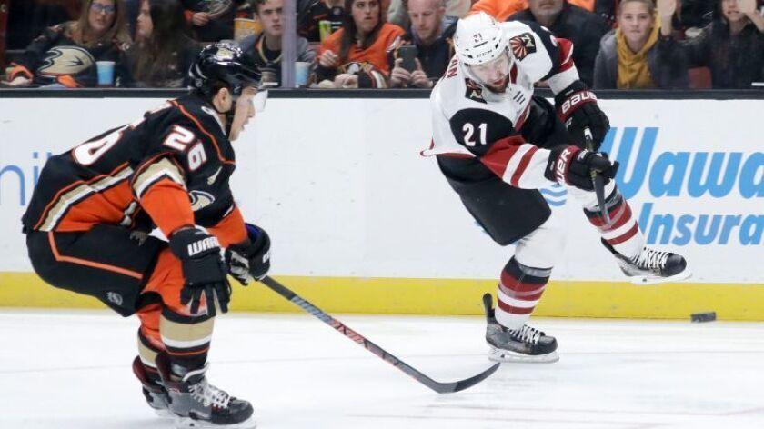 Arizona Coyotes center Derek Stepan, right, shoots past Anaheim Ducks defenseman Brandon Montour during the first period.