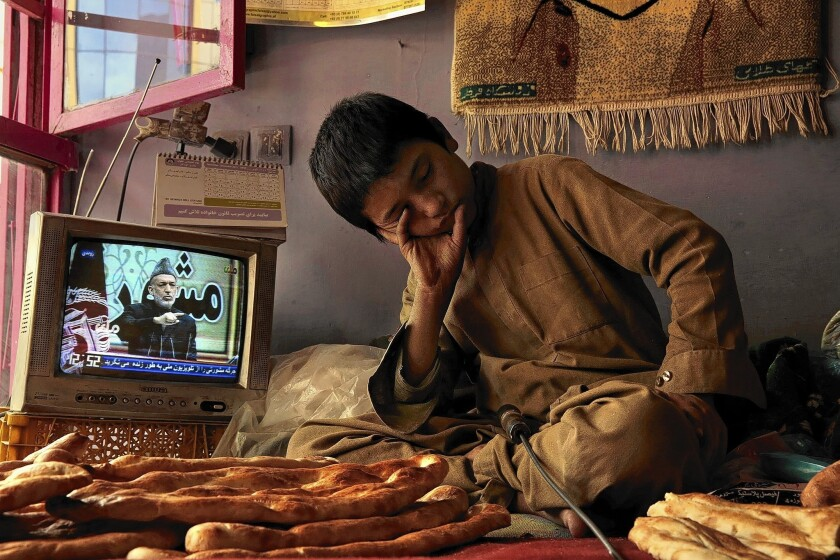 Sami Rahimi, 13, works and lives in a bread bakery in Kabul. He gets up at 5 a.m. to start work. He supports his entire family, who live in the northern province of Tahar.