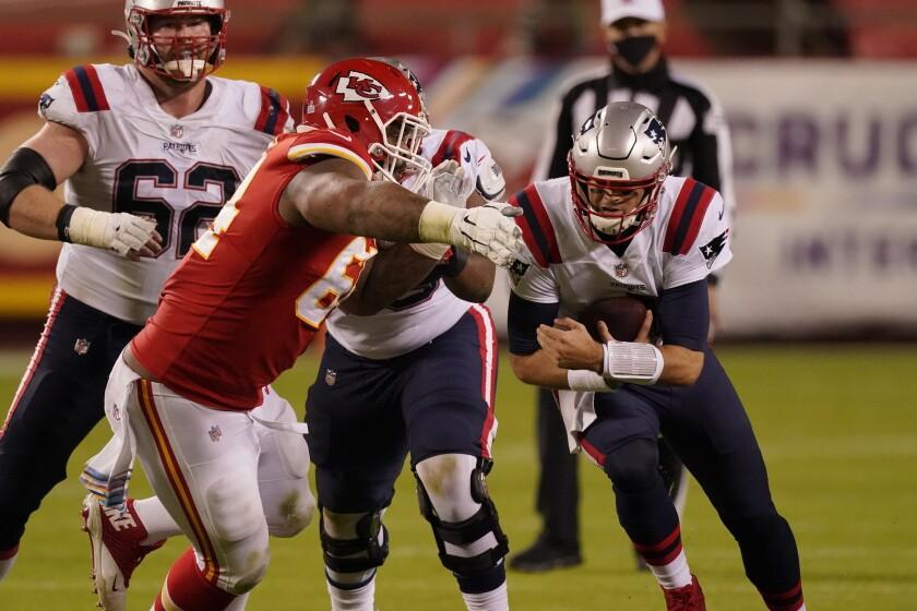 New England Patriots quarterback Jarrett Stidham runs the ball against the Kansas City Chiefs defense.
