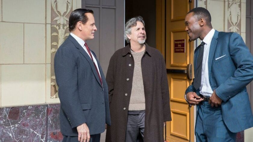 """Viggo Mortensen, from left, director Peter Farrelly and Mahershala Ali on the set of """"Green Book."""""""