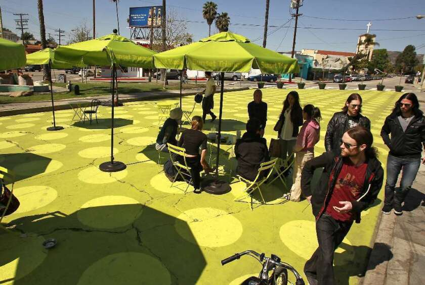 """Sunset Triangle Plaza, a pocket park in Silver Lake in 2012. The Pasadena Playhouse District Assn. will turn two parking spaces on Colorado Boulevard into """"parklets"""" Friday during PARK(ing) Day."""
