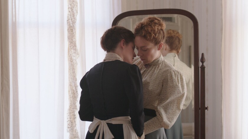 "Kristen Stewart, left, and Chloe Sevigny in the film ""Lizzie."""