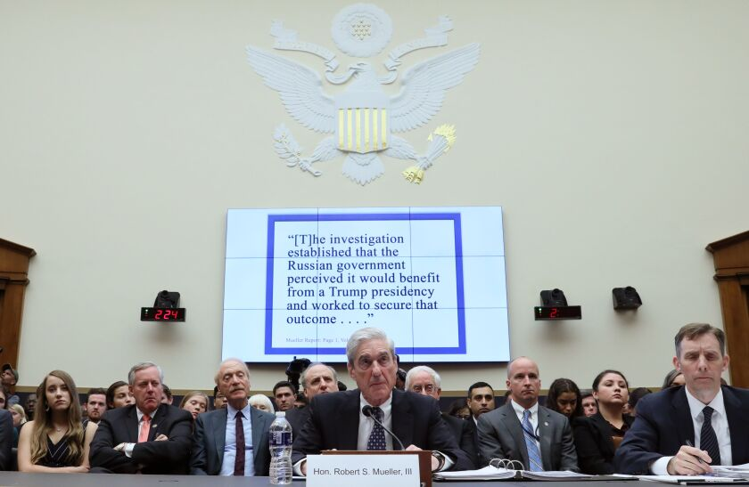 Former Special Counsel Robert Mueller testifies on Capitol Hill.