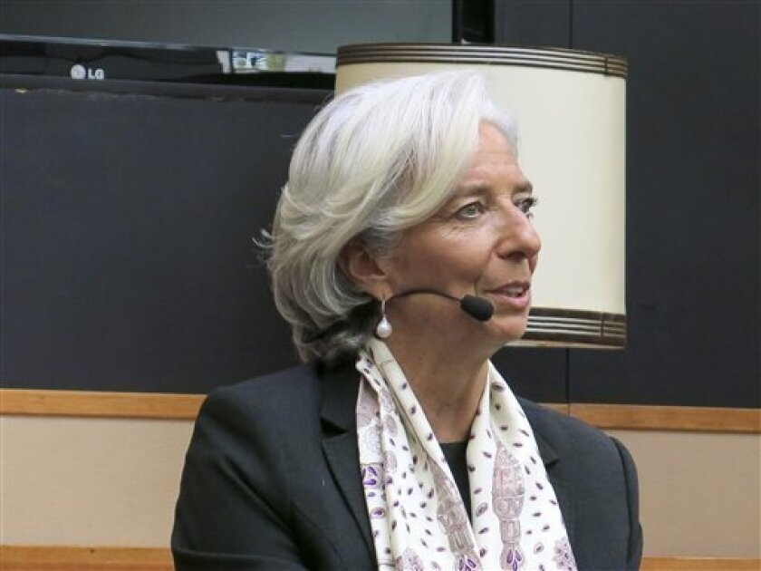 International Monetary Fund head Christine Lagarde speaks to students at the University of Amsterdam, Netherlands, Tuesday, May 7, 2013. Lagarde criticized the U.S. government's budget policies as too tight on Tuesday, in an appearance in Amsterdam that was interrupted by student protestors. Security guards dragged students away until there were none left shouting, and eventually the interview resumed. (AP Photo/Toby Sterling)