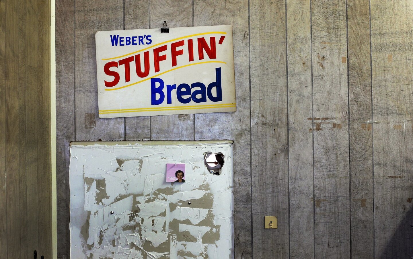 Bread & Salt (former Weber bakery) in Barrio Logan is being turned into live-work space, design space, and will host a San Diego Museum of Art gallery. Here, a sign from the old bakery hangs on the wall.