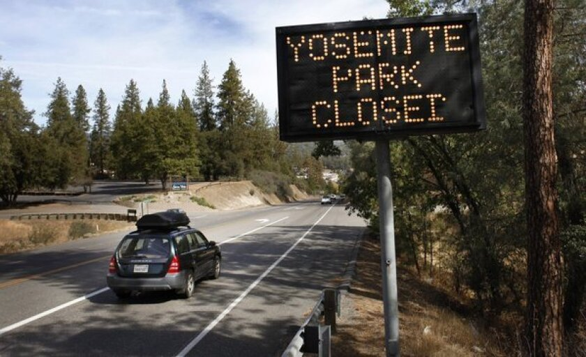 A sign on Route 41 in Oakhurst, Calif., notifies travelers that Yosemite Park is closed Tuesday.