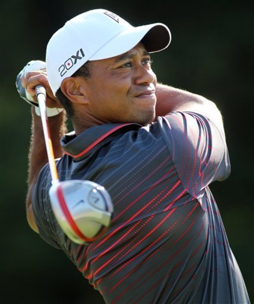 Tiger Woods tees off on the 13th hole during the first round of the Deutsche Bank Championship golf tournament at TPC Boston in Norton, Mass., Friday, Aug. 31, 2012. (AP Photo/Stew Milne)