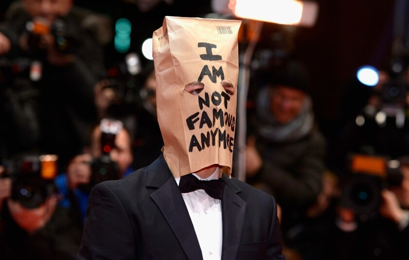 """Shia LaBeouf attends the """"Nymphomaniac"""" premiere at the 64th Berlin International Film Festival wearing a paper bag on his head."""
