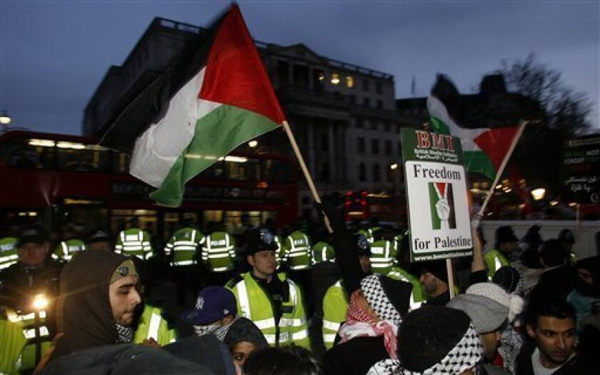 Protesters face British police officers during a rally in Trafalgar Square against Israel's military operations in the Gaza Strip, central London, Saturday, Jan. 17, 2009. There were continued protests against the Israeli military action Saturday in London and several other British cities. (AP Phot