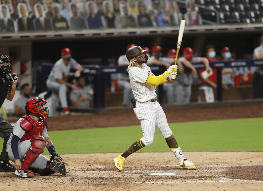 Fernando Tatis Jr. of the Padres hits a home run in the seventh inning of Game 2 of the NL Wild-Card Series.