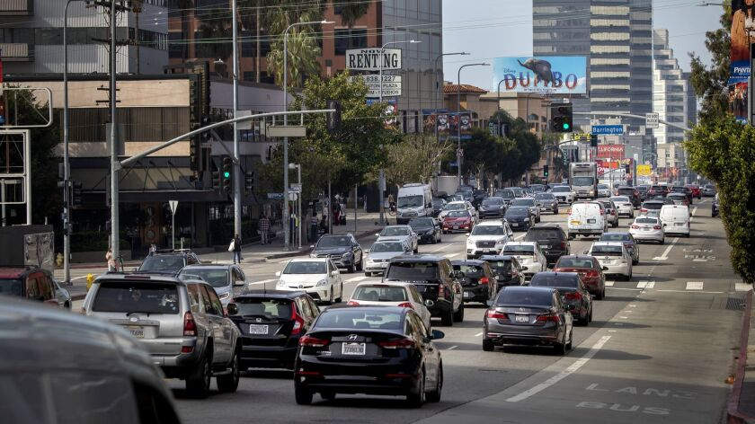 Morning rush-hour traffic moves slowly along Wilshire Boulevard west of the 405 Freeway in Los Angeles.