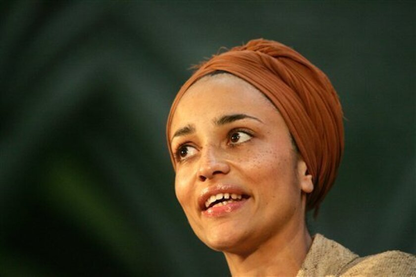 FILE - In this Tuesday, June 6, 2006 file photo British author Zadie Smith speaks after winning the Orange Prize for Fiction for her third novel 'On Beauty' at an award ceremony at the Royal Court of Justice in London. The lineup of 20 writers under 40 announced Monday April 15, 2013 included newcomer Taiye Selasi and established best-seller Zadie Smith who have been named to Granta magazine's list of best young British novelists _ a once-a-decade roster with a reputation for predicting literary