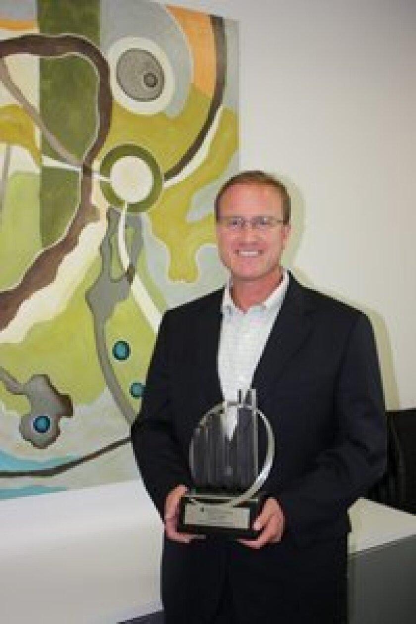 Dr. Arthur Gruen with his award.