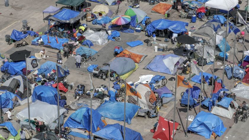 A homeless encampment in the Plaza of the Flags area next to the Orange County Superior Courthouse.
