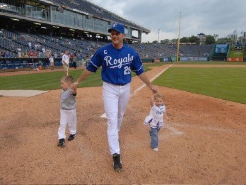 RSF resident and former MLB player Mike Sweeney with his children, Michael and McKara. Courtesy photos