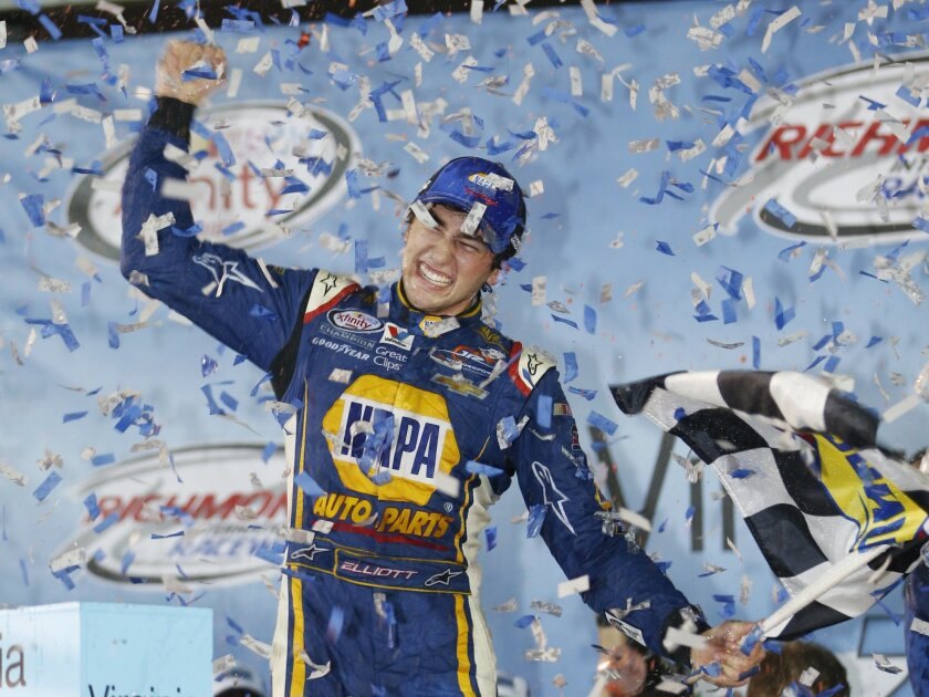 FILE - In this Sept. 11, 2015, file photo, Chase Elliott celebrates winning the NASCAR Xfinity Series auto race at Richmond International Raceway in Richmond, Va. With four-time champion Jeff Gordon retired and three-time champ Tony Stewart sidelined with a broken back, the NASCAR season begins wit