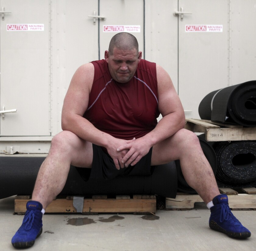 FILE - In this July 14, 2011, file photo, Rulon Gardner takes a breather while training in Colorado Springs, Colo., for a comeback at the 2012 Olympic Games in London. An Olympic Channel documentary debuting Wednesday, July 22, 2020, chronicles the highs and lows of Rulon Gardner in the 20 years since his stunning gold-medal victory in the 2000 Olympics. (Genna Ord/The Gazette via AP)