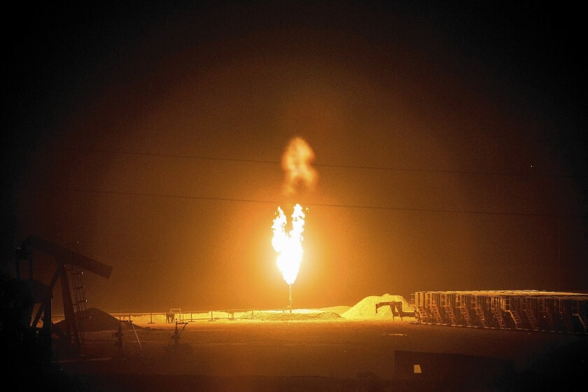 A gas flare outside Williston, N.D. The rapid escalation of oil production in the state has resulted in natural gas being burned off as waste.
