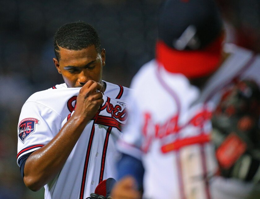 Atlanta Braves pitcher Julio Teheran reacts after giving up 3 runs to the Los Angeles Dodgers in the sixth inning to fall behind 3-1 in a baseball game on Monday, Aug. 11, 2014, in Atlanta. (AP Photo/Atlanta Journal-Constitution, Curtis Compton) MARIETTA DAILY OUT; GWINNETT DAILY POST OUT; LOCAL TELEVISION OUT; WXIA-TV OUT; WGCL-TV OUT