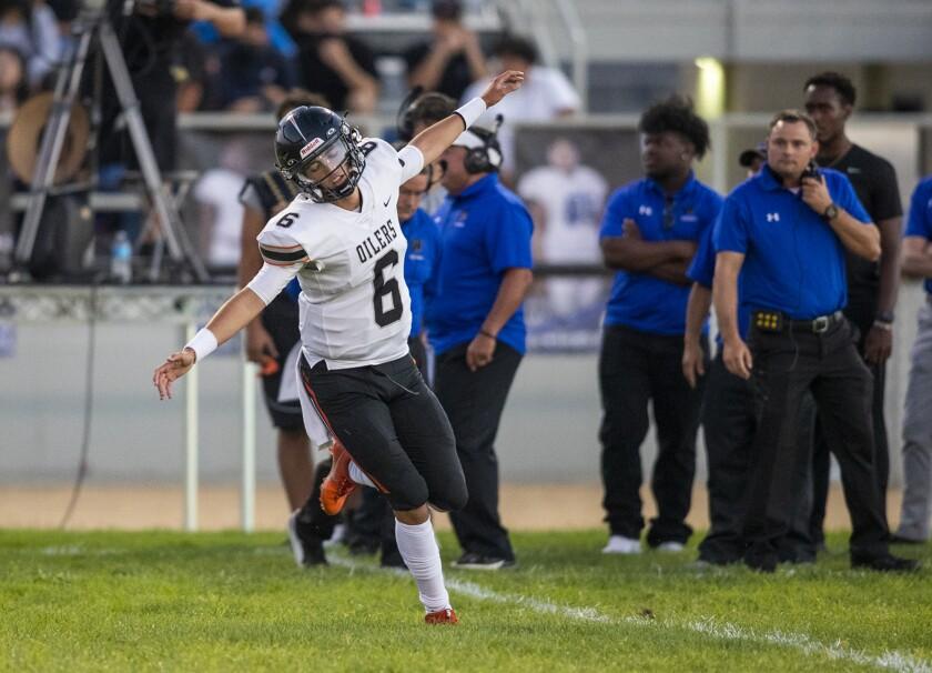 Huntington Beach quarterback AJ Perez, shown on Aug. 26, had four touchdown passes in Friday's win over Long Beach Wilson.