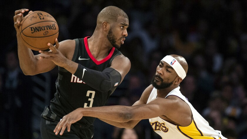 Los Angeles Lakers forward Corey Brewer, right, defends Houston Rockets guard Chris Paul (3) during
